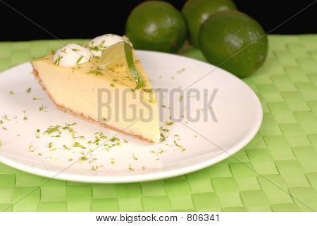 Key lime pie on white plate