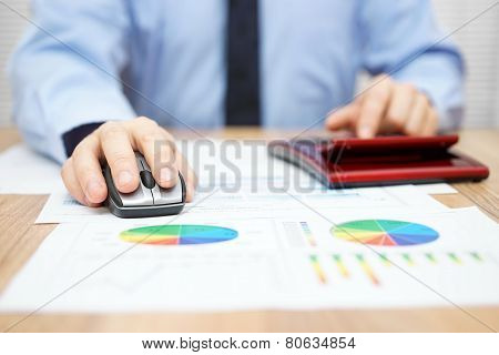 Businessman Is Calculating Data And Using Computer To Insert Financial Information And Data Into Rep