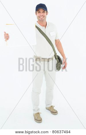 Portrait of happy courier man showing envelops on white background