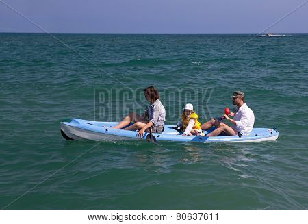 Family canoeing in the sea.