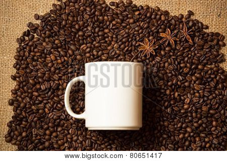 White Mug Against Of Coffee Background With Star Anise