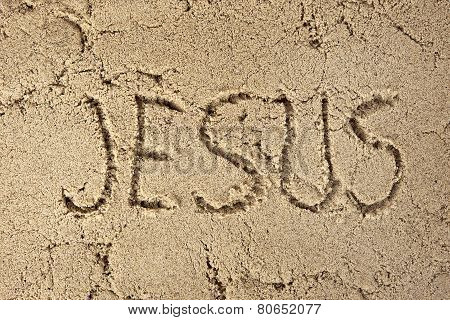 Jesus written in sand