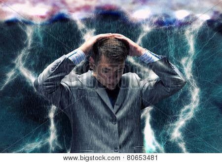 Frustrated businessman protecting his head with arms