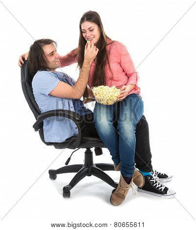 Man And Woman Sitting Together In Armchair Eating Pop Corn