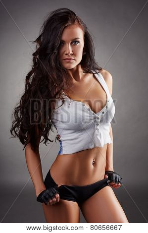 Portrait of sexy fitness girl on gray background
