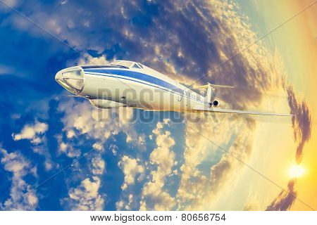 passenger plane flying in the sky at sunrise