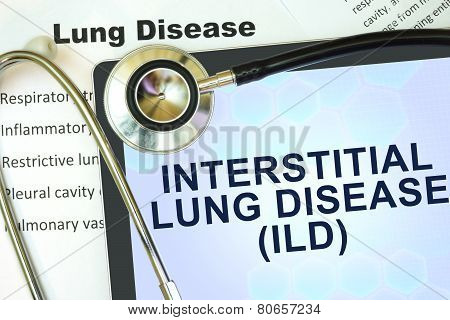 Tablet with word Interstitial lung disease (ILD) and stethoscope.