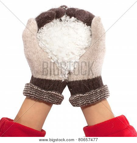 hands with snow like heart