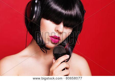 Closeup portrait of beautiful woman with microphone. Karaoke