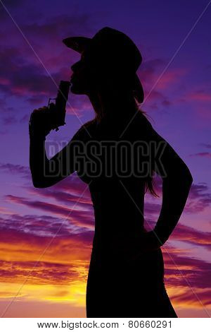 Silhouette Of Woman Cowboy Hat With Gun Blow Close Sunset