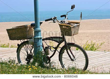 bicycle with baskets on boardwalk