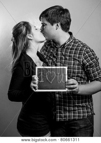 Monochrome Portrait Of Kissing Couple In Love Holding