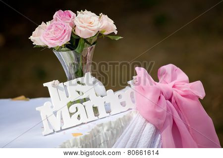 Just Married Sign With Bunch Of Roses And Pink Ribbon