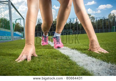 Slim Sporty Woman Getting Ready To Run On Grass Track