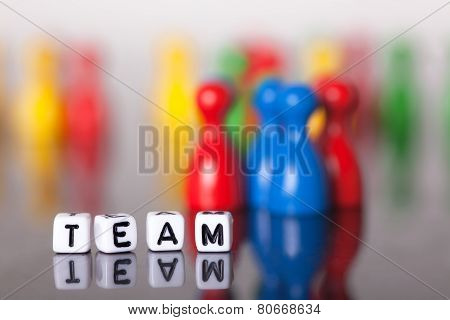 Cube Letters Show The Word Team