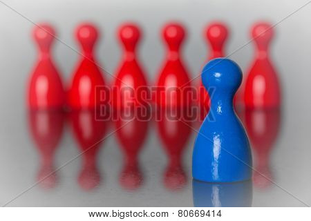 One Blue Figure In Front Of Red Figures