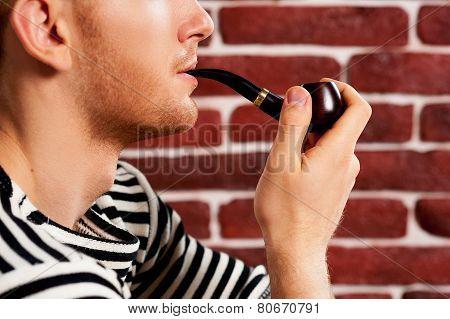Smoking A Pipe.