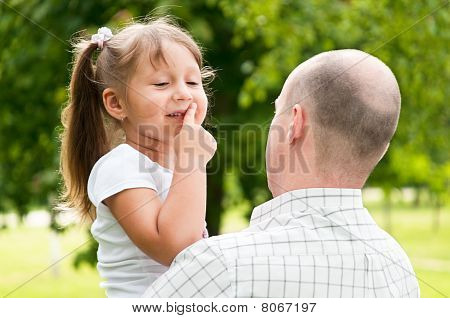 Father And His Daughter In Park