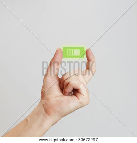 Hand holding battery icon