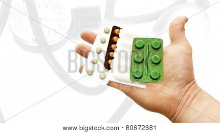 Different Pills In Hand