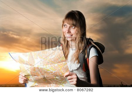 Young Woman With Map And Backpack