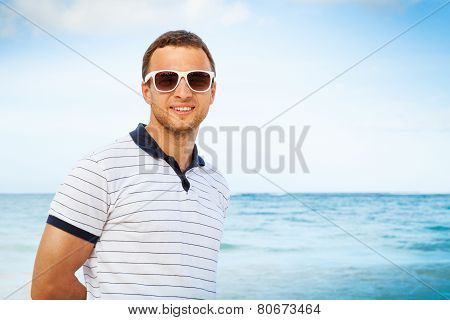 Caucasian Man In White Sunglasses On Sea Coast
