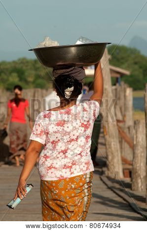 Myanmar Woman Carrying On Her Head.