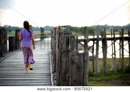 Residents And Visitors Traveling On The U-Bein Bridge,myanmar.