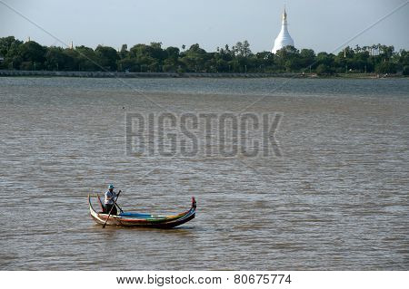 Traditional boat on the lake near U-Bein Bridge in Myanmar.