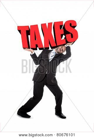 Businessman In Stress Carrying Heavy Taxes 3D Text Word On Shoulders As Painful Burden In Tax Paying
