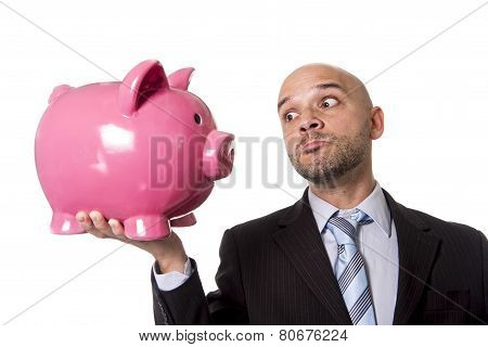 Businessman Holding Piggybank Face To Face Looking The Piggy Bank In The Eye