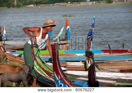 Traditional Boat On The Shore Of The Lake Near Uben Bridge.