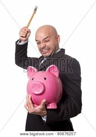 Bald Hispanic Businessman With Hammer In His Hand Holding Pink Piggybank Ready To Break The Piggy Ba