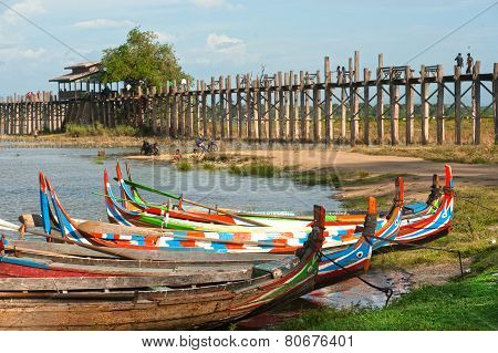 Traditional Boat On The Shore Of The Lake Near U-Bein Bridge.