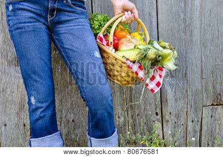 young girl with basket of vegetables