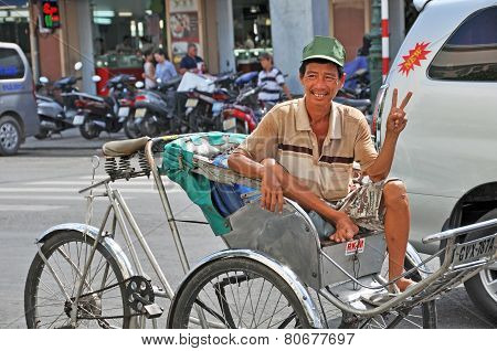 Happy Cyclo Driver At Ben Tanh Market Ho Chi Minh City