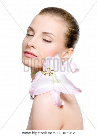 Woman With Flower On A Shoulder With Closed Eyes