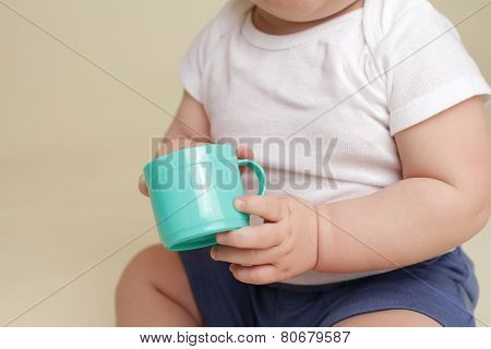 Child Holding A Cup, Eating Or Drinking