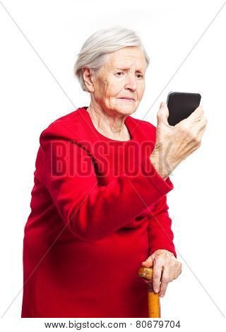 Upset elderly woman using touch screen mobile