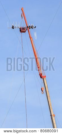 Telecommunication Site, Hoisting Crane Tower Lifting The Dipole Antenna.