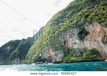 View of Maya Bay, Phi Phi island, Thailand, Phuket. Seascape of tropical island with resorts