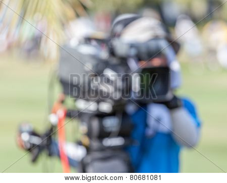 Blurred Background Of Sport Photographer Is Working During Golf Tournament.