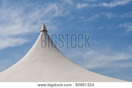 Looking Up At The Top Of White Tent Against Beautiful Blue Sky.