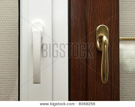 Window System Handles. White And Gold Items.