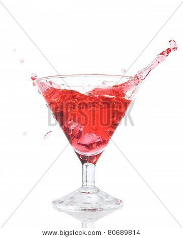 Red Cocktail Splash In The Glass Isolated