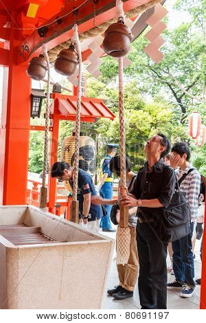Tokyo,japan - May 25, 2014  Many People Donate Money And Benediction At Temple  Tokyo,japan