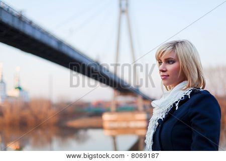 Young Woman Against A Bridge.