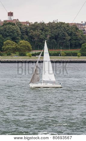 White Sailboat In Choppy Water