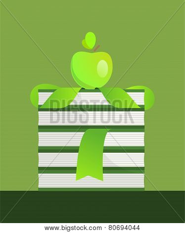 Green apple and books stack