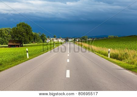 View Of Countryside Road After Thunder Storm